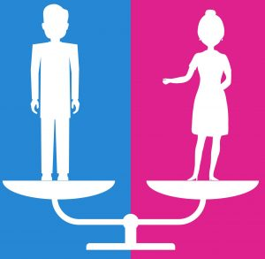 Gender equality. A man and a woman are on equal footing on the scales.